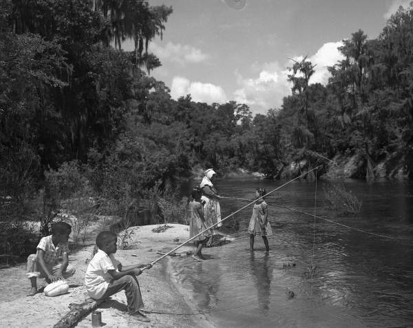 Thelma Boltin and the Bryant children fishing along the Suwannee River 1957