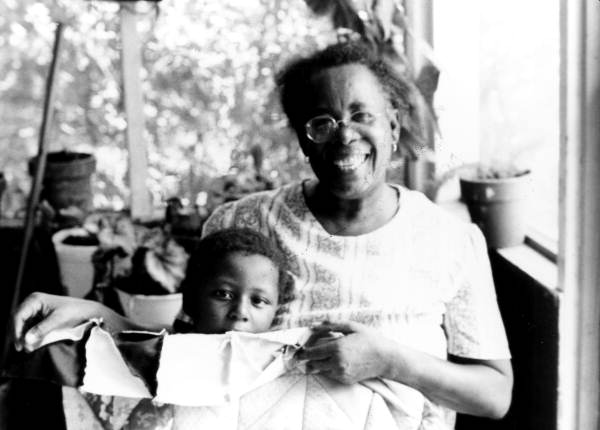 Portrait of Claudie Mae Hamilton With Child and One of Her Quilts in Gainesville Florida. Courtesy of Florida Memory Collection, Florida State Archives